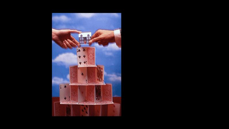 Diapositivo com imagem de casa de cartas
